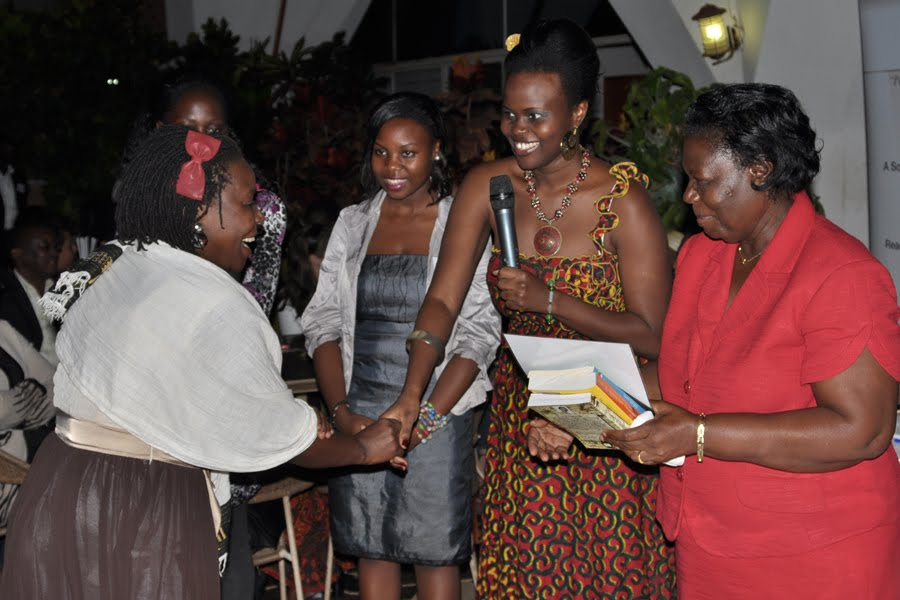 Betty Kittuyi, receiving the Third Prize for BN Poetry Awards Uganda, 2012